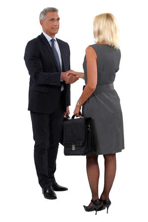 Two businesspeople shaking hands photo