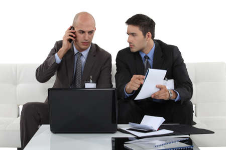 two businessmen preparing a deal photo