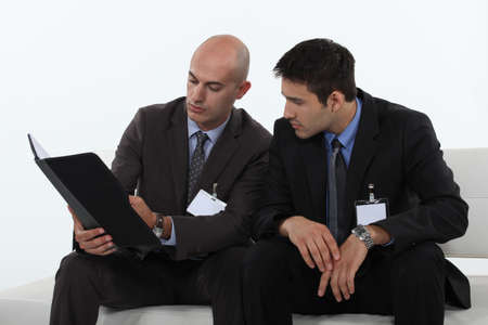 businessmen reading a report Stock Photo