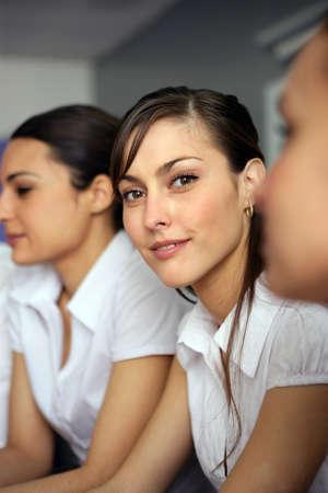 Three brunettes having business meeting photo