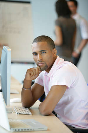 Casual worker thinking whilst sat at computer Stock Photo - 13839448