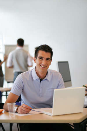 Man happily working at his desk photo