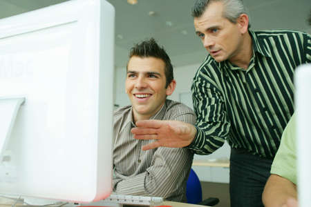 Man teaching computer skills Stock Photo