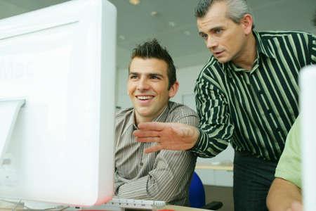 internship: Man teaching computer skills Stock Photo