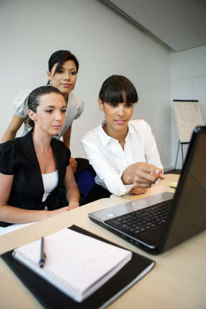 Office workers at a laptop Stock Photo - 13839312