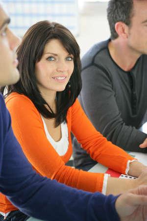 personal development: Woman participating in a seminar Stock Photo