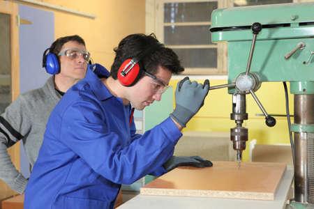 Laborers in workshop photo