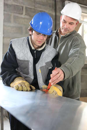 Apprentice  and foreman on construction site photo
