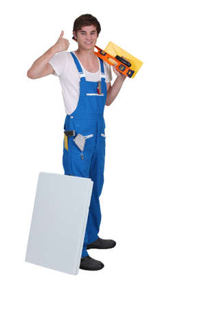 Young plasterer with tools of the trade photo