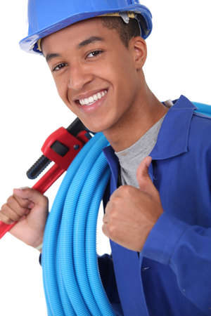 Young plumber with a wrench photo