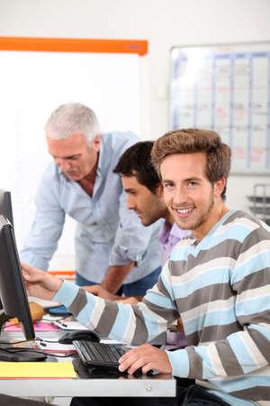 Smiling man in computing training photo