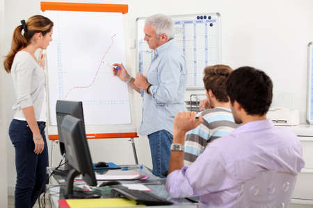 Man showing growth on a presentation board Stock Photo - 13841836