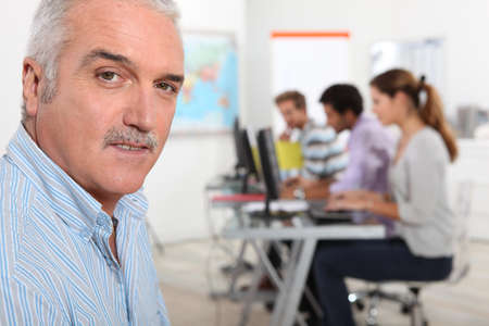 continuing education: A teacher in his classroom Stock Photo