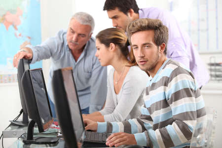 continuing education: People working on computers Stock Photo