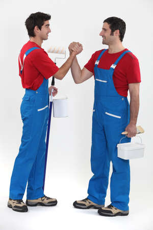 Two decorators greeting each other Stock Photo - 13841897