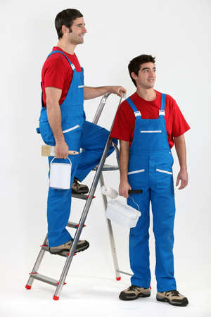 paintbucket: Two decorators stood by ladder Stock Photo