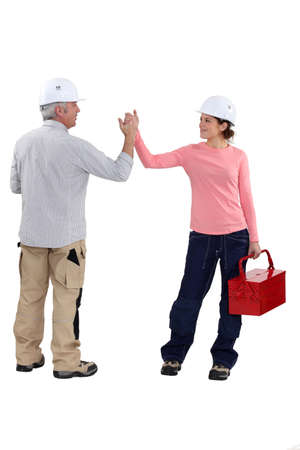 Man and woman holding hands and tools Stock Photo - 13839208