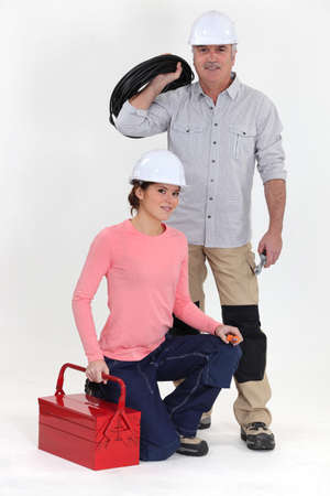 An electrician and his apprentice. Stock Photo - 13841733