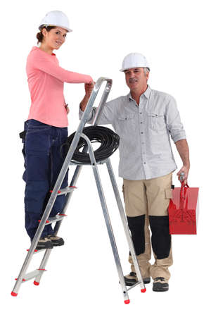 jobbing: Electrician and apprentice on a ladder Stock Photo