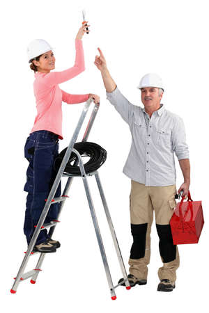 Experienced tradesman pointing to his assistant Stock Photo - 13839450