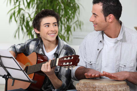 Father and son playing music together photo