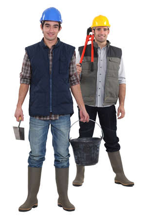 jumpsuit: Two constructions workers stood together Stock Photo