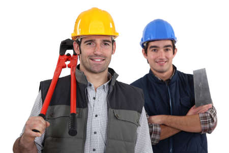 self help: craftsman and apprentice posing together Stock Photo