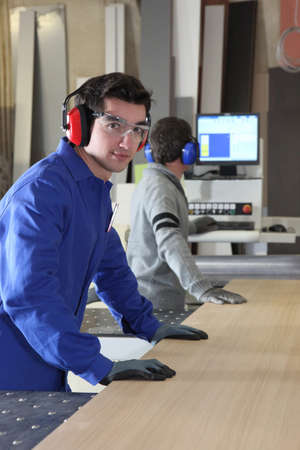 workbench: Two factory workers using band-saw Stock Photo