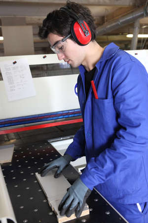 earmuff: Factory worker wearing ear defenders