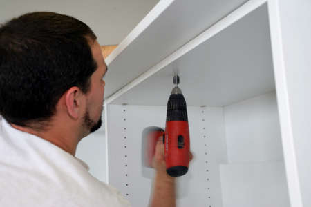 Handyman building cabinet photo