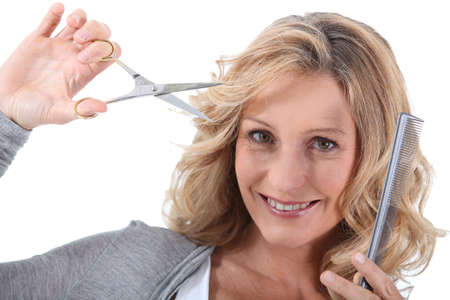 snipping: Hairdresser with scissors and a comb Stock Photo