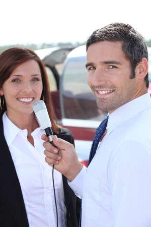 A journalist interviewing woman photo
