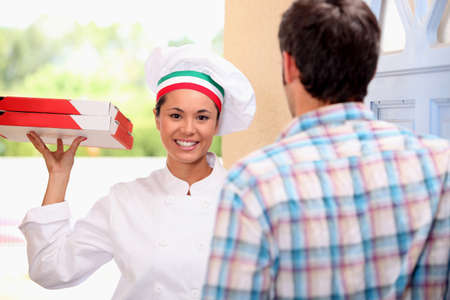 Woman delivering pizza Stock Photo - 13839499