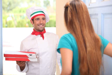 pizza delivery: Man delivering pizza Stock Photo