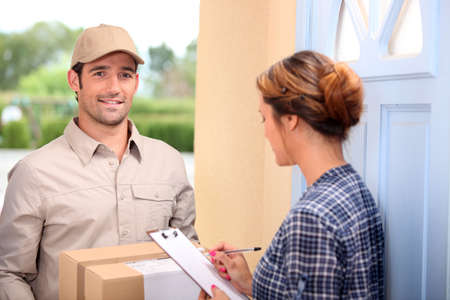 delivering: man delivering pallet Stock Photo