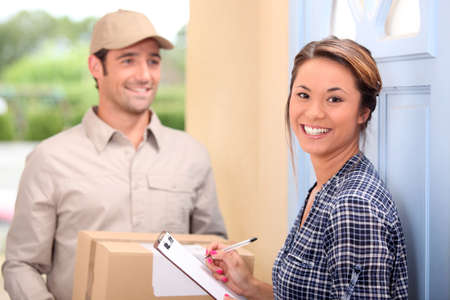 fragile industry: Delivery man and young woman Stock Photo