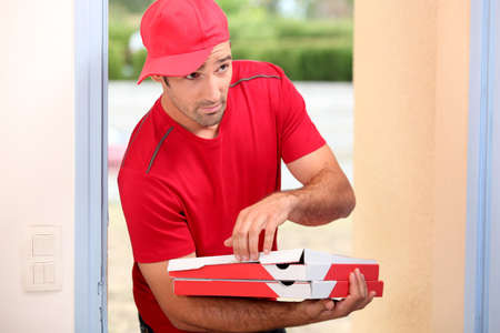 Delivery man with pizza boxes photo