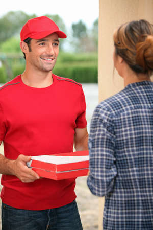 delivery man: Man delivering pizza Stock Photo