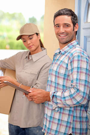 Man collecting package at home photo