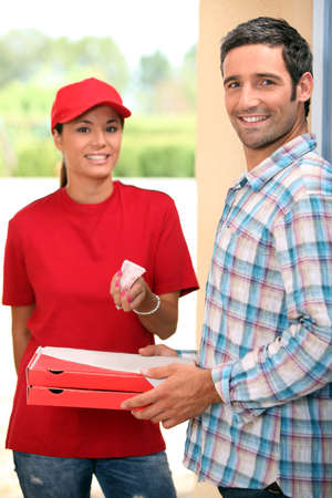 Woman delivering pizza photo