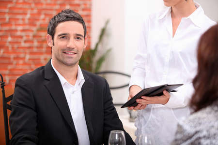 blazer: Couple having a meal in a fancy restaurant