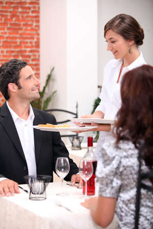 Waitress serving customers Stock Photo - 13841923
