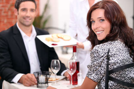 Couple eating in a restaurant photo