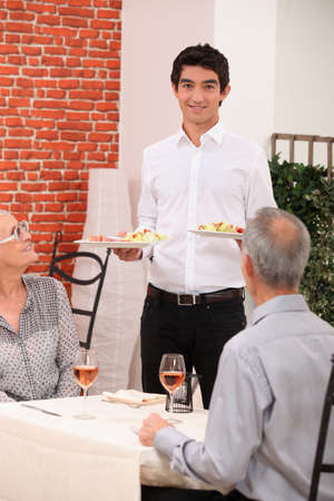 Senior couple dining in restaurant photo