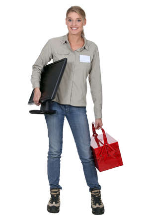 blonde woman holding a computer screen and a tool box photo