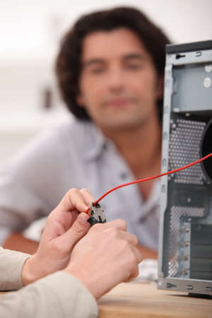 close-up of hands fixing computer photo