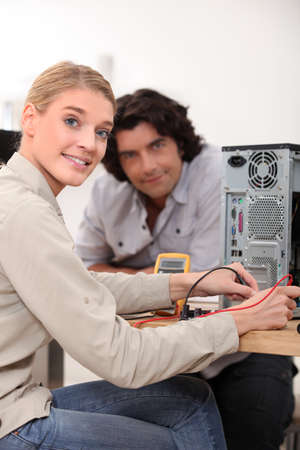 Woman assessing problem with computer photo