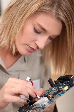 Woman with electronic component photo