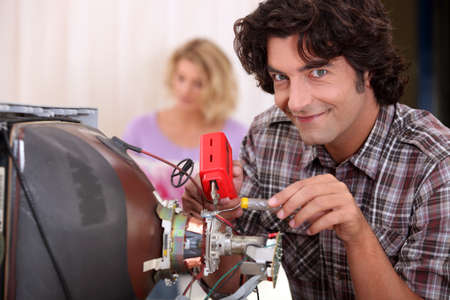 Man repairing television set photo