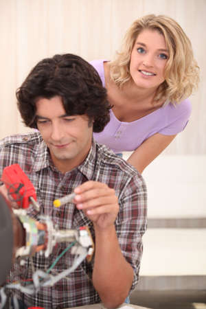 Couple repairing their television Stock Photo - 13841893